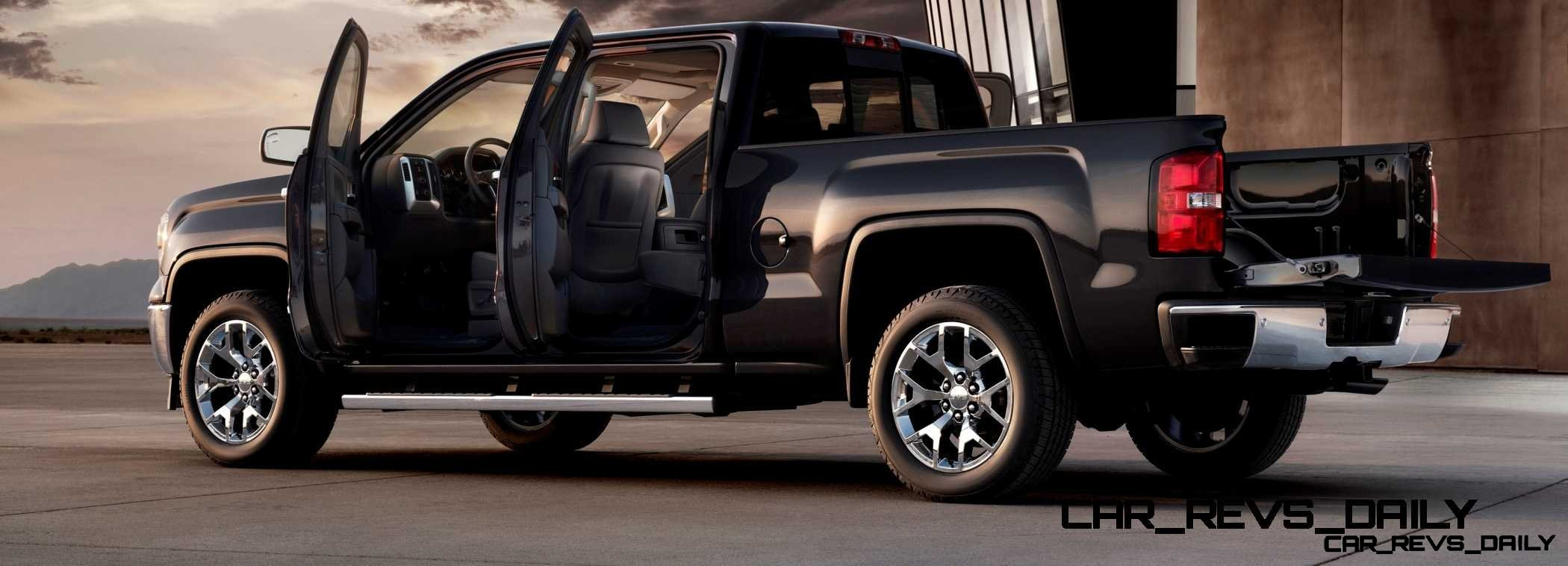 2014 GMC Sierra SLT Crew Cab in Iridium Metallic left rear three quarter shot doors open- on location
