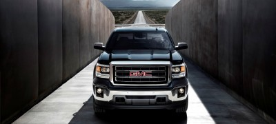 2014 GMC Sierra SLT Crew Cab in Iridium Metallic head on shot- on location