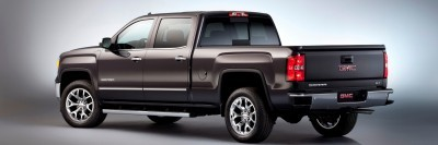 2014 GMC Sierra SLT Crew Cab Rear Three Quarter in Iridium Metallic - Studio