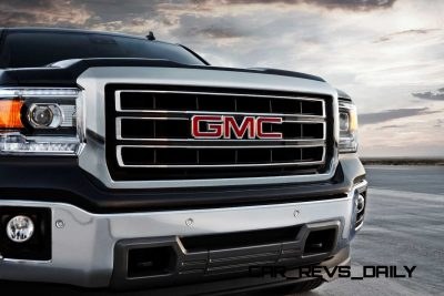 2014 GMC Sierra SLT Crew Cab in Iridium Metallic front end detail - on location