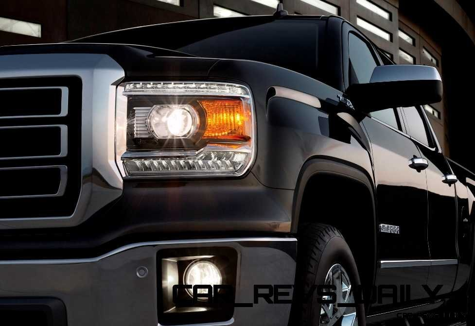 2014 GMC Sierra SLT Crew Cab in Iridium Metallic headlamp detail - on location