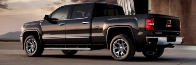 2014 GMC Sierra SLT Crew Cab in Iridium Metallic left rear three quarter shot- on location