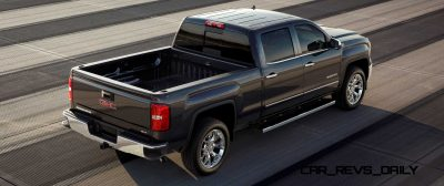 2014 GMC Sierra SLT Crew Cab in Iridium Metallic rear three quarter shot from above - on location