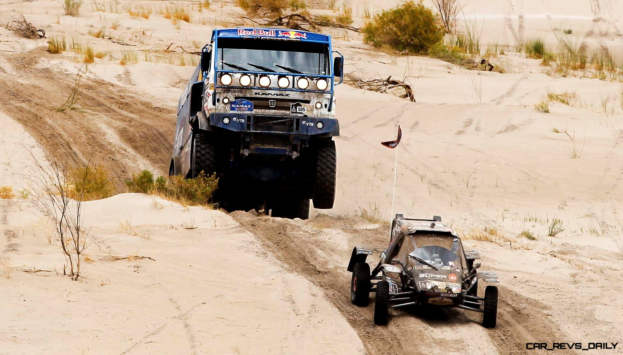 Ayrat Mardeev, Aydar Belyaev and Anton Mirniy, all of Russia, race their Kamaz truck behind the buggy of Jurgen Van Den Goorbergh of The Netherlands during the 11th stage of the 2013 Dakar Rally from La Rioja to Fiambala, Argentina, Wednesday, Jan
