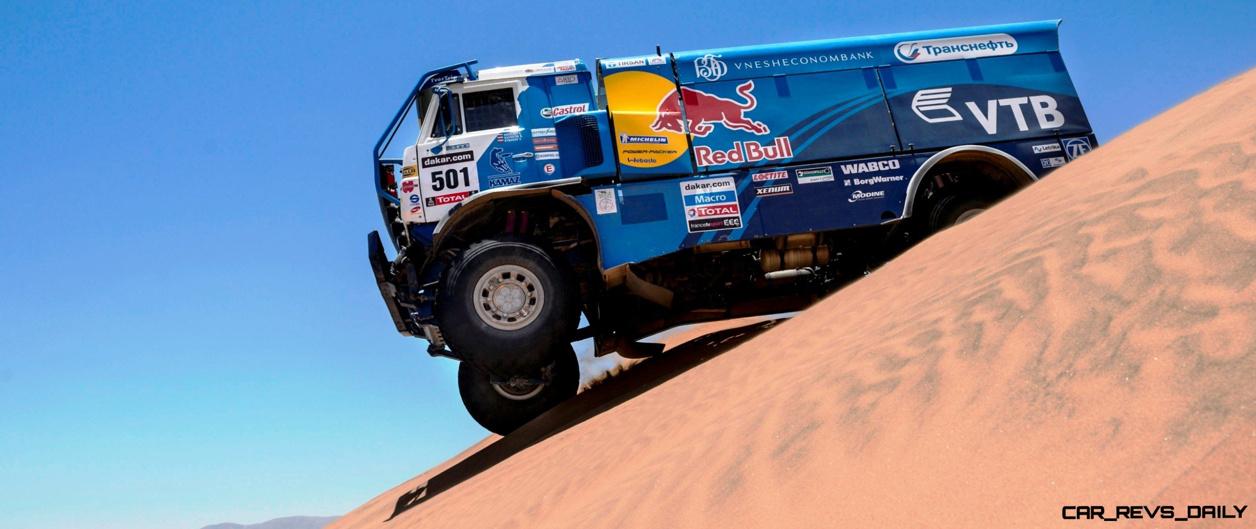 Eduard Nikolaev (driver) Sergey Savostin (co-driver) and Vladimir Rybakov (co-driver) race during the 13th stage of Dakar Rally from Copiapo to La Serena, Chile on January 18th, 2013