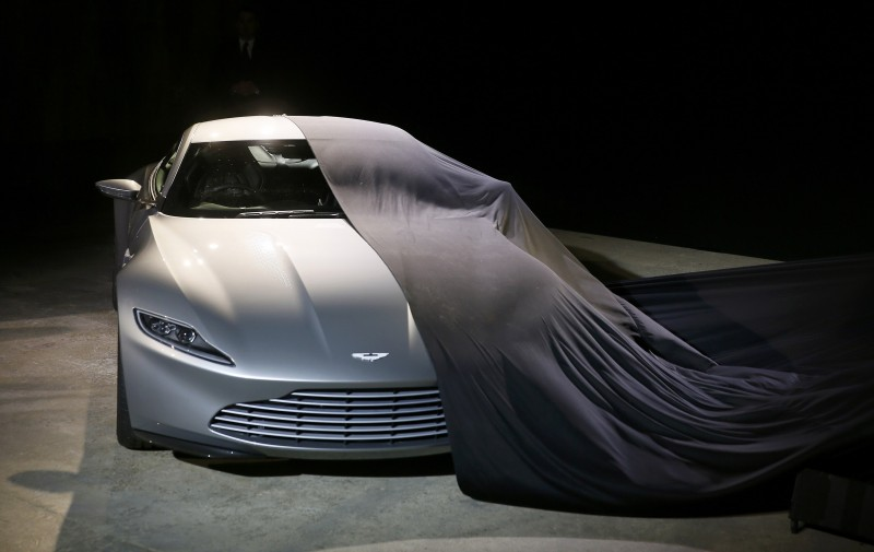 "An Aston Martin DB10 car is unveiled on stage during an event to mark the start of production for the new James Bond film ""Spectre"" at Pinewood Studios"