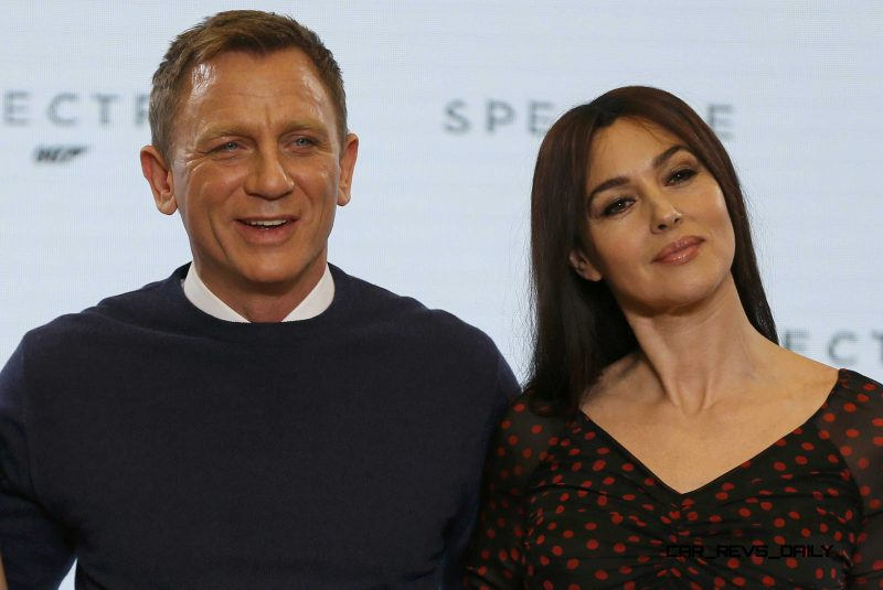 "Actors Daniel Craig and Monica Bellucci pose on stage during an event to mark the start of production for the new James Bond film ""Spectre"" at Pinewood Studios"