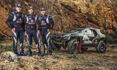 Carlos Sainz, Cyril Despres and  Stephane Peterhansel pose for a