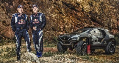 Lucas Cruz and Carlos Sainz pose for a portrait during the Peuge