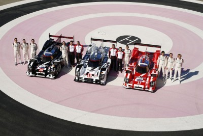 Porsche 919 Hybrid in 2015 Le Mans colors with drivers and top management