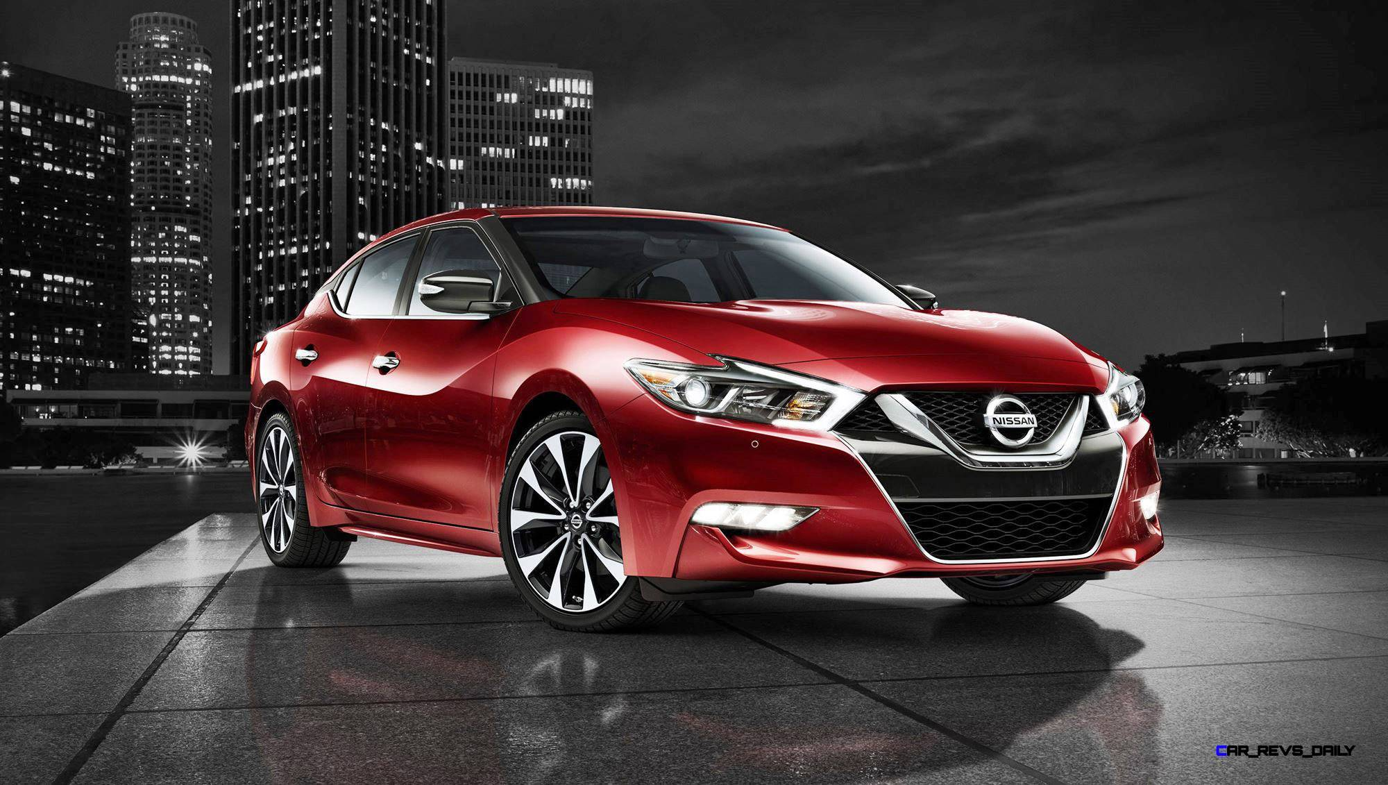 2016 nissan maxima coulis red side view night skyline zoom
