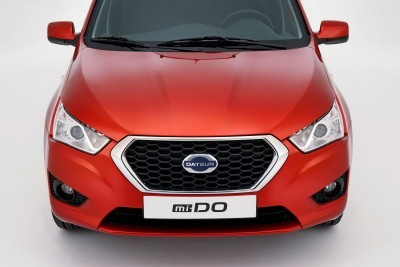 """The Datsun mi-DO is a practical yet sporty five-door hatchback with a strong masculine appearance: modern, robust and confident. Among its stand out features are its """"face"""" dominated by Datsun's confident """"D-Cut"""" grille and which, in turn, is flanked by dramatically elongated projector headlamps that stretch virtually from grille to fender to create a look that differentiates sedan and hatchback at a glance."""