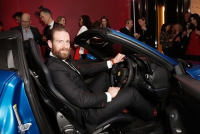 Craig McCinlay inside the Ferrari 488 Spider at the UK launch at the Watches of Switzerland store London