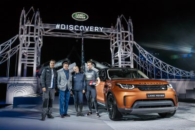 bear-grylls-land-rovers-gerry-mcgovern-zara-phillips-and-sir-ben-ainslie-at-the-launch-of-the-new-land-rover-discovery-in-front-of-the-worlds-largest-lego-structure