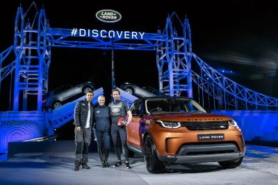 bear-grylls-zara-phillips-and-sir-ben-ainslie-pose-by-the-new-land-rover-discovery-in-front-of-a-world-record-breaking-lego-tower-bridge-structure