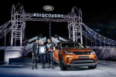 bear-grylls-zara-phillips-and-sir-ben-ainslie-stand-with-the-new-land-rover-discovery-in-front-of-the-world-record-breaking-lego-structure-packington-hall-solihull