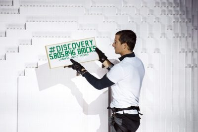 bear-grylls-lays-the-record-breaking-lego-brick-to-land-rovers-tower-bridge-structure-at-packington-hall-solihull