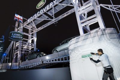 bear-grylls-places-the-final-lego-brick-onto-the-worlds-largest-lego-structure-at-global-unveiling-of-land-rovers-new-discovery-at-packington-hall-solihull-uk