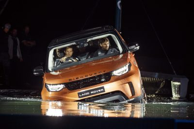 land-rover-bar-team-principal-sir-ben-ainslie-drives-the-new-land-rover-discovery-at-global-unveiling-at-packington-hall-solihull-uk-accompanied-by-team-manager-jono-macbeth