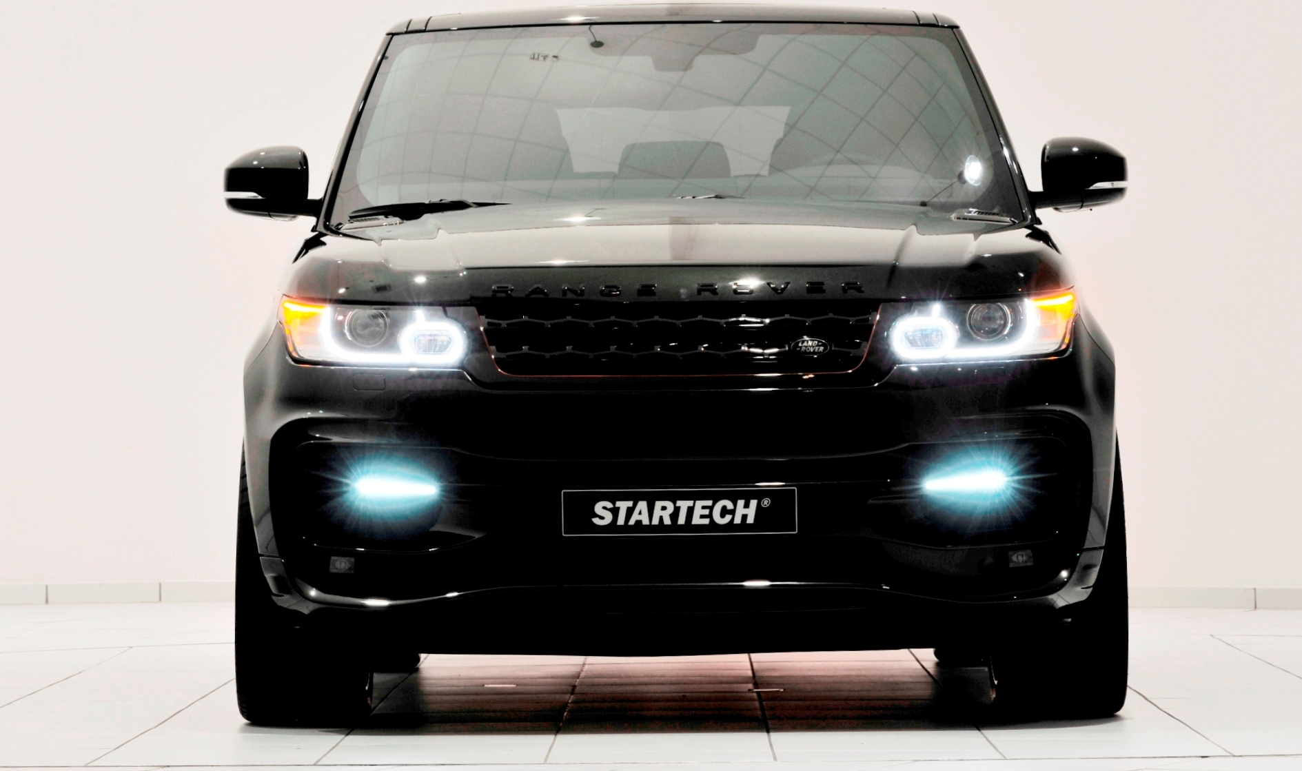 2014 range rover sport by startech is gorgeous even without the