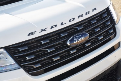 The front end of the 2017 Ford Explorer XLT Sport Appearance Package features a Magnetic Gray grille and nameplate badging across the hood. Preproduction model shown in White Platinum Metallic; available summer 2016.