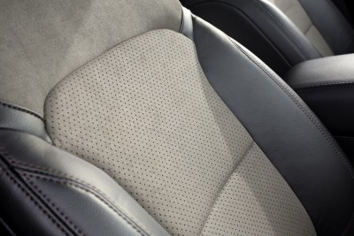 Front seats for the 2017 Ford Explorer equipped with the XLT Sport Appearance Package feature Dark Earth Gray leather on the outer bolsters, Dark Earth Gray Miko® suede on the upper backs, and Dark Earth Gray Miko suede inserts with Umber scrim on the backs. Preproduction model shown; available summer 2016.