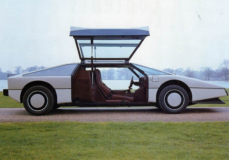 Car-Revs-Daily.com Concept Flashback - 1979 Aston Martin Bulldog vs 2014 Aston Martin DP-100 Vision GranTurismo 4